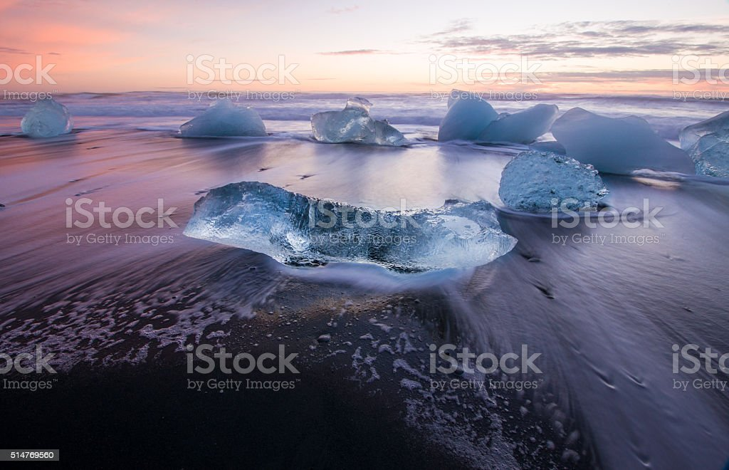 Ice on the black volcanic beach, Jokulsarlon glacier lagoon, Iceland. stock photo