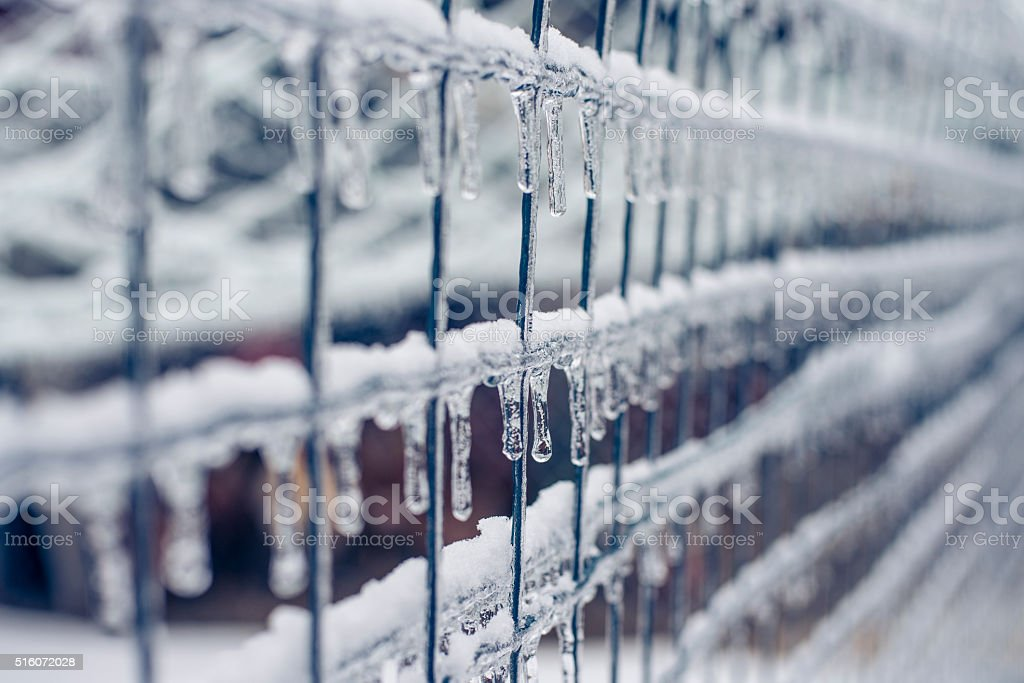 Ice on wire fence in winter stock photo