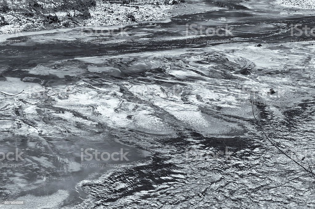 Ice patches on river stock photo