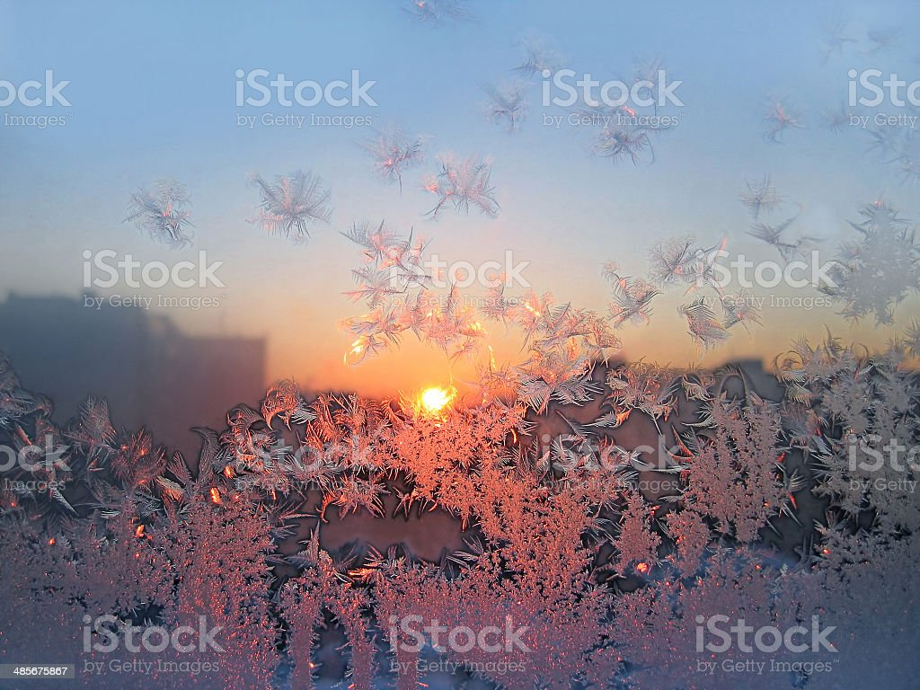 Ice pattern and sunlight on glass stock photo