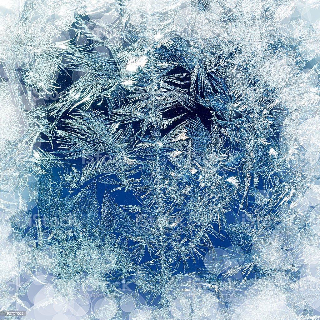 Ice pattern on window in winter day stock photo