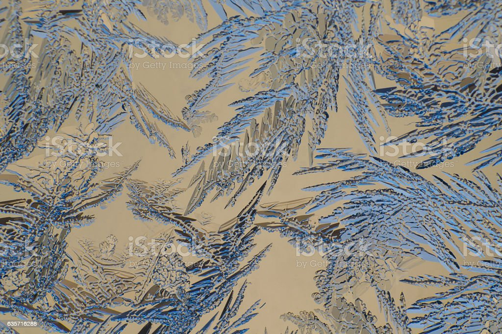 Ice patterns on glass stock photo