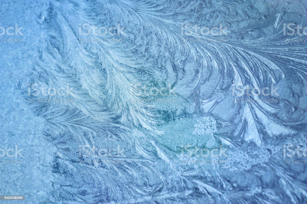 Ice patterns on winter glass stock photo
