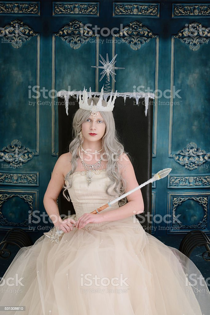 ice queen sitting on her throne stock photo