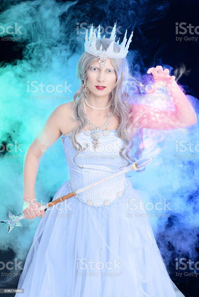 ice queen using magic stock photo