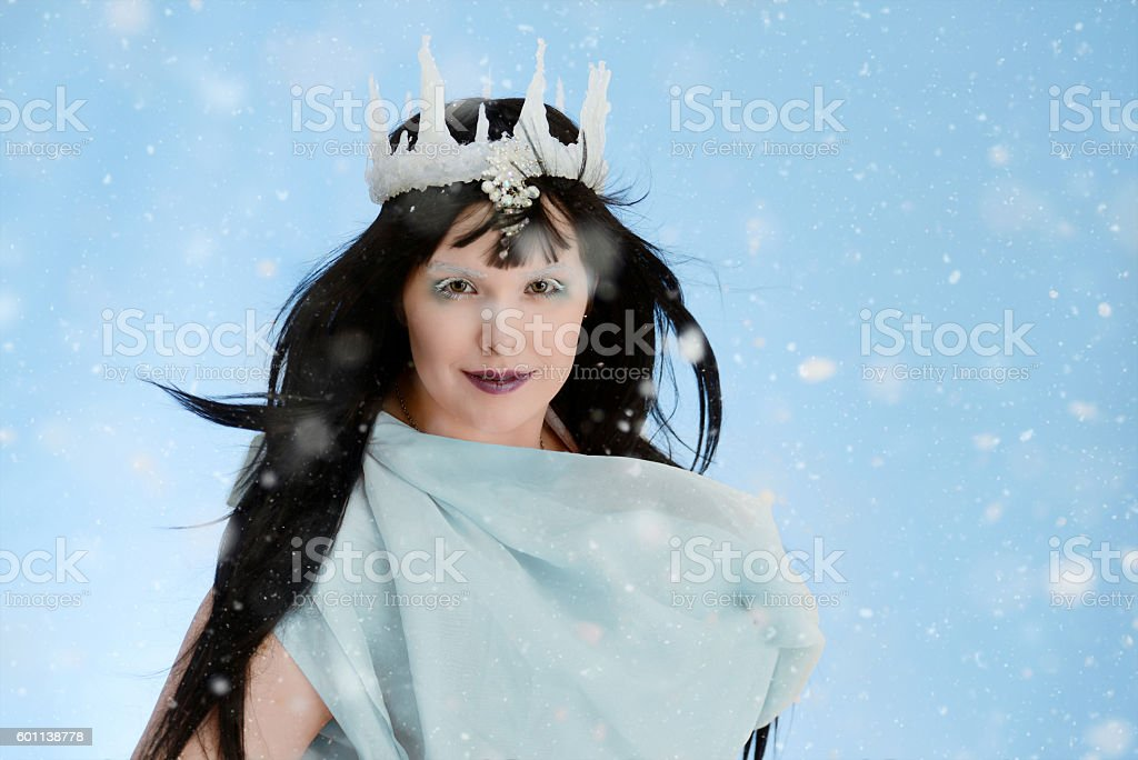 Ice queen with blue dress stock photo