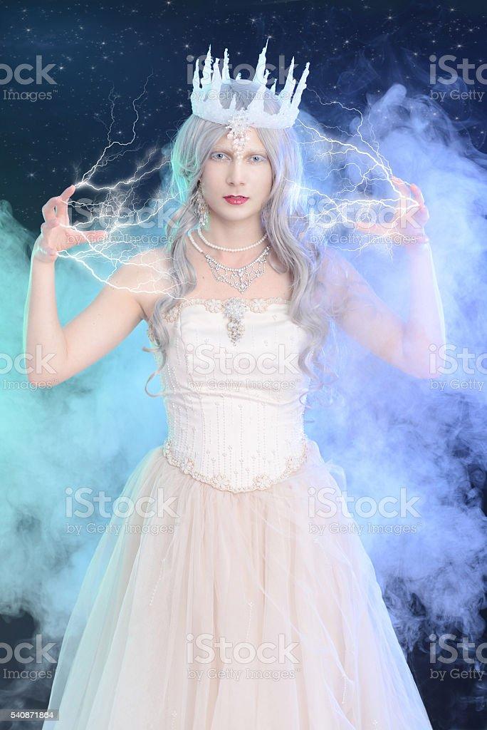 ice queen with lighting magic stock photo