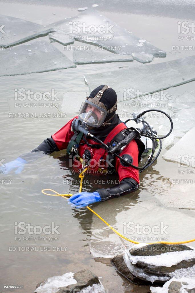 Ice rescue drill of DLRG at River Rhine - Einsatztaucher stock photo