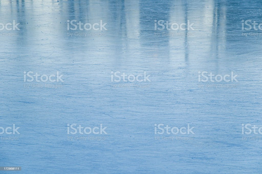 Ice rink covered with texture of ice skating marks royalty-free stock photo