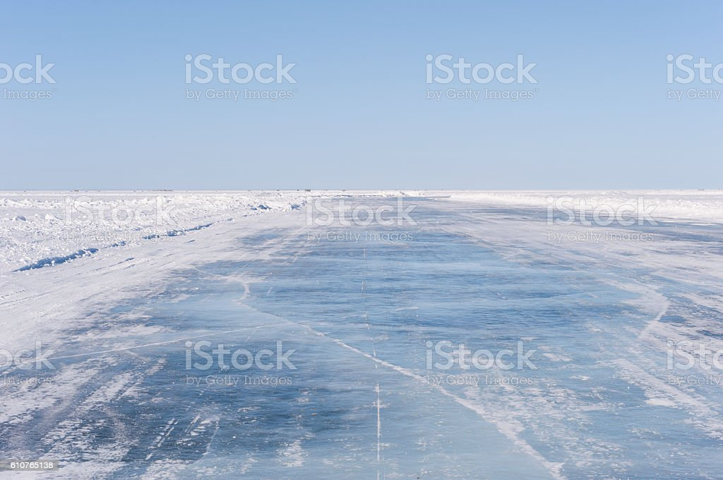 Ice Road on Frozen Lake. stock photo