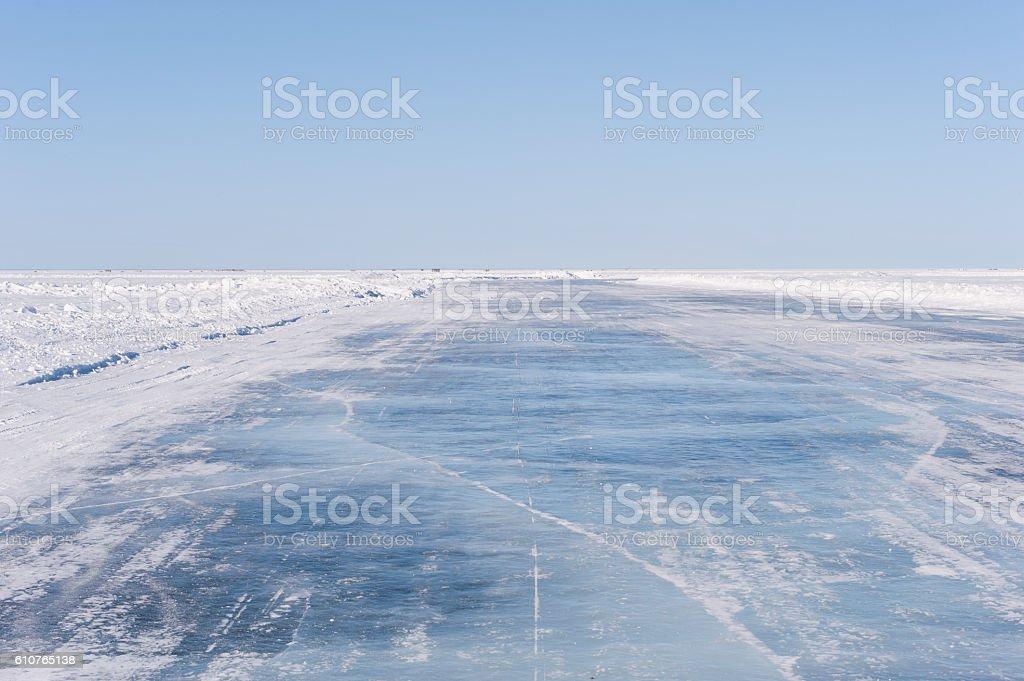 Ice Road on Frozen Lake. stock photo