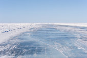 Ice Road on Frozen Lake.