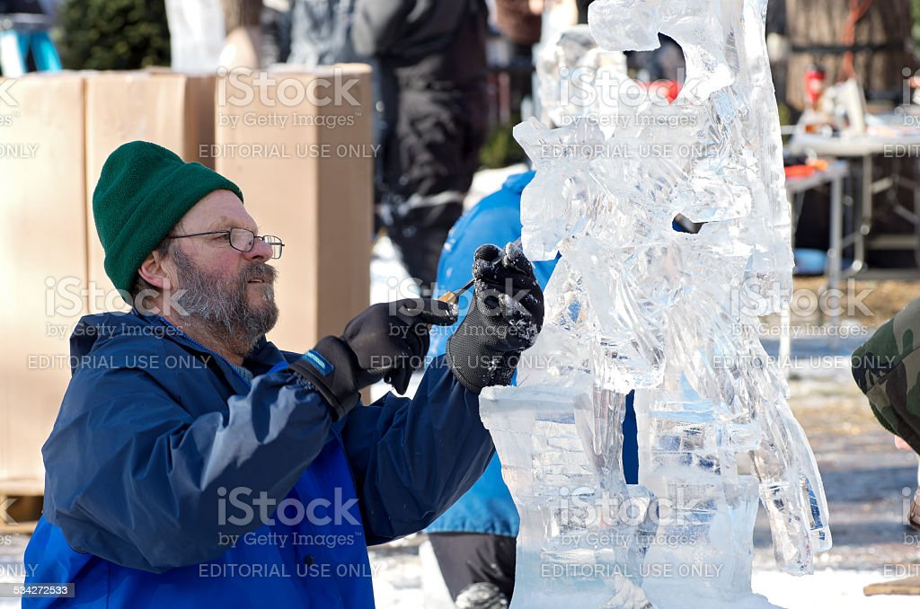 Ice Sculptor at Winter Carnival stock photo