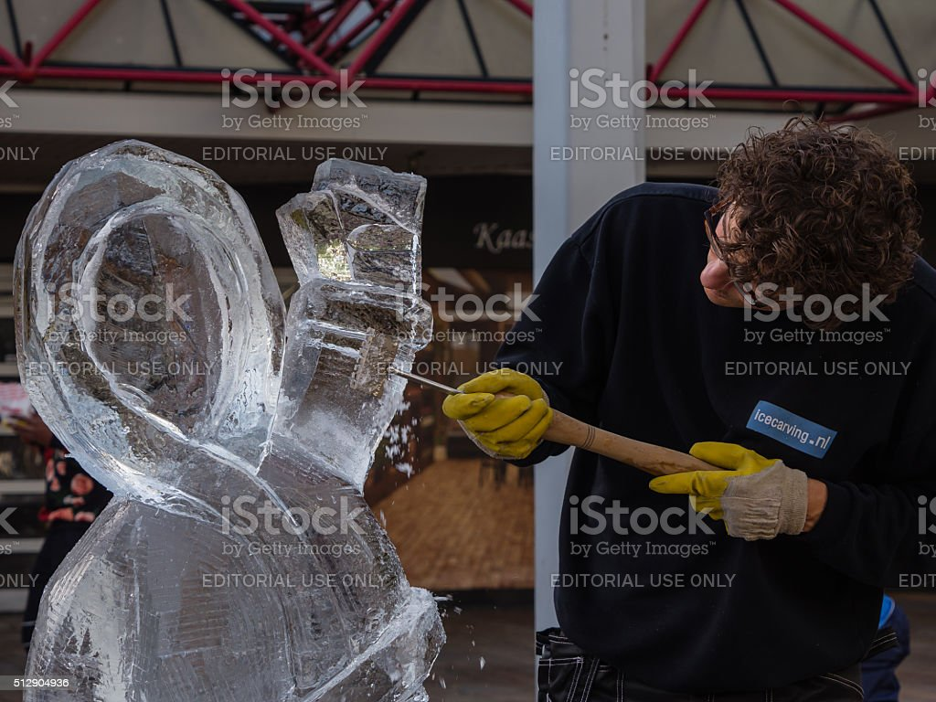 Ice sculptor at work stock photo