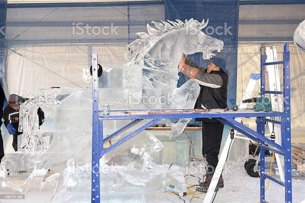 Ice sculptors at work stock photo