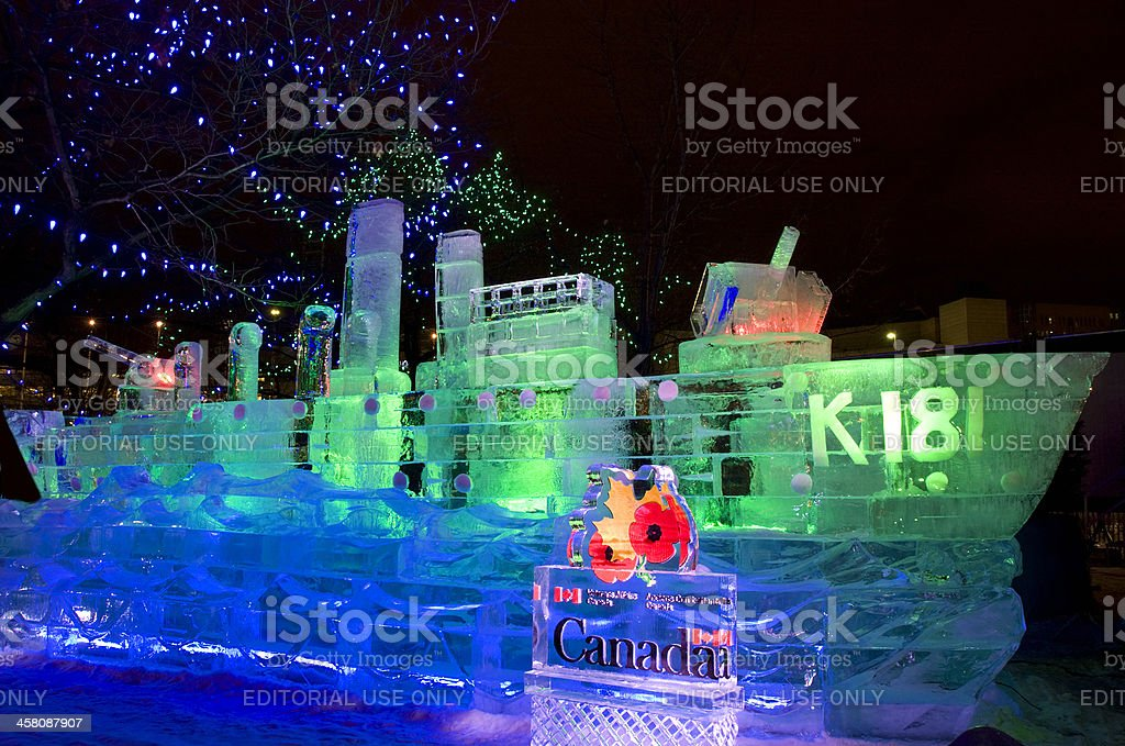 Ice sculpture of a Military Ship at night stock photo