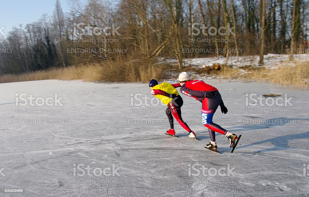 Ice skaters in action stock photo