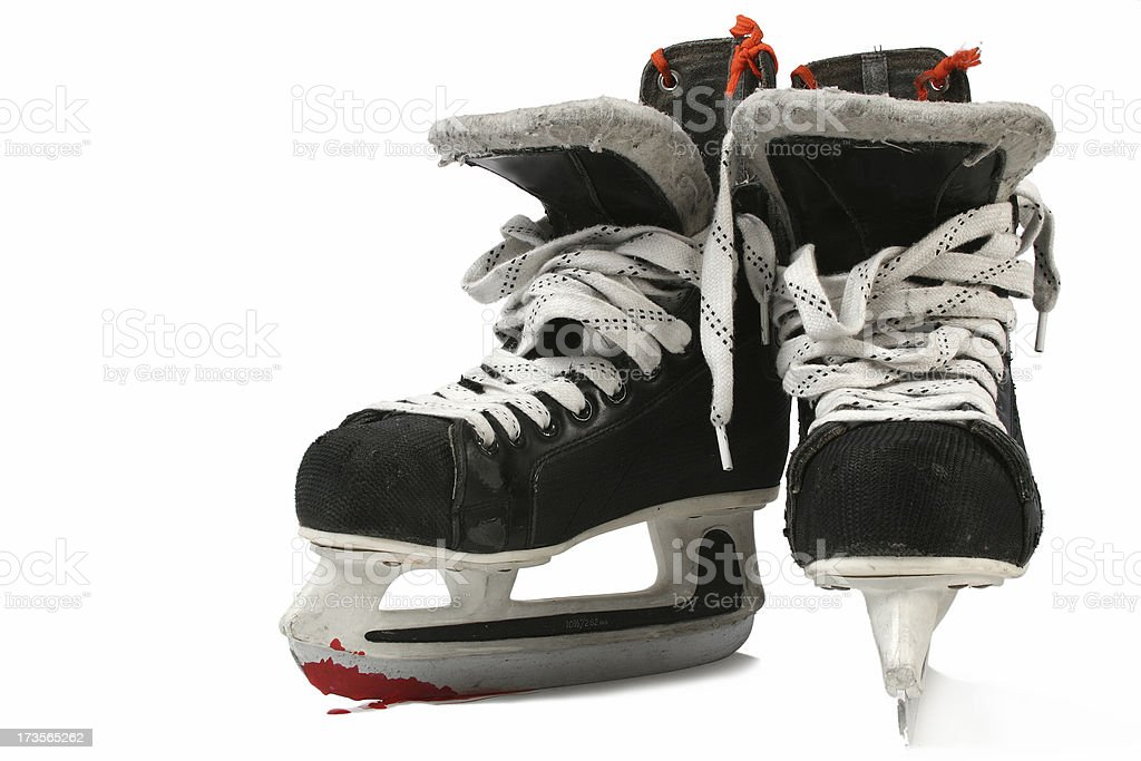 Ice skates and blood royalty-free stock photo