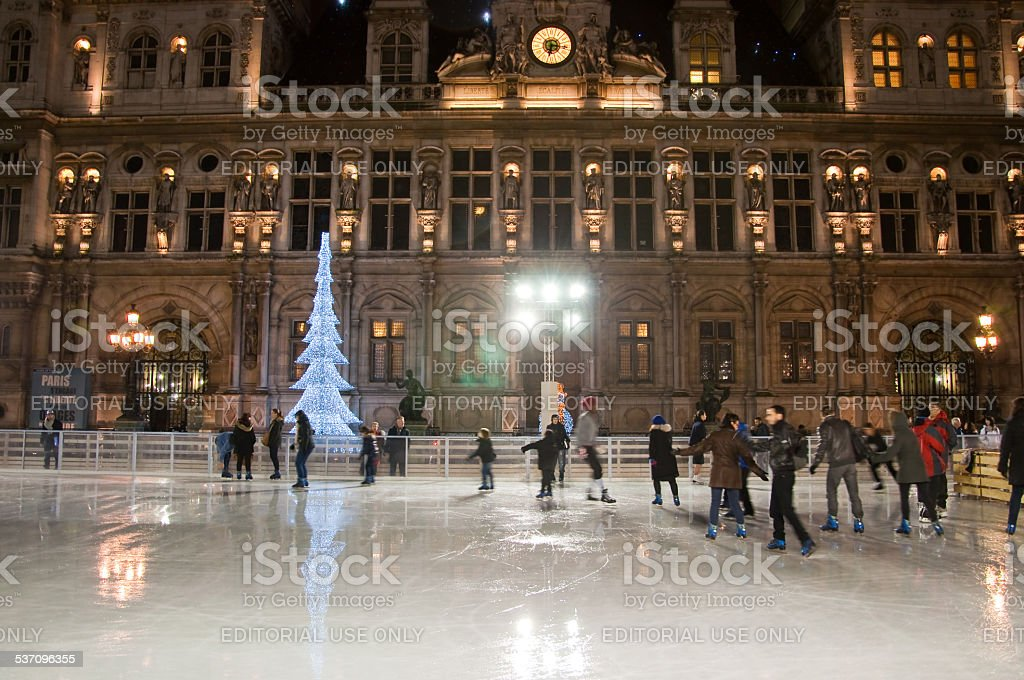 Ice skating and the Hotel de ville at night. Paris. stock photo