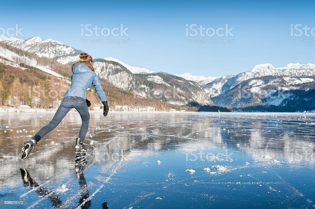 Ice Skating, Frozen Lake Grundlsee, Austria stock photo