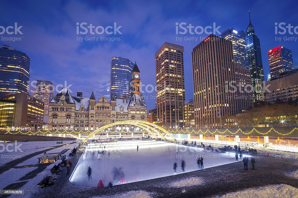 Ice skating in Nathan Phillips Square at night stock photo