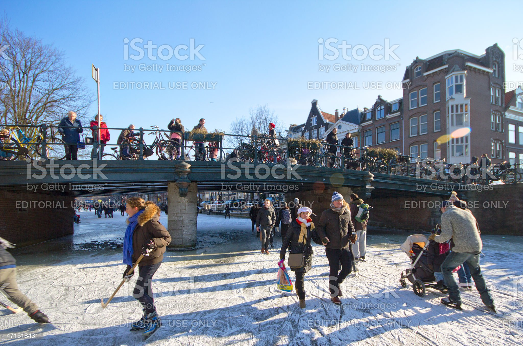 Ice skating in the Amsterdam canals royalty-free stock photo