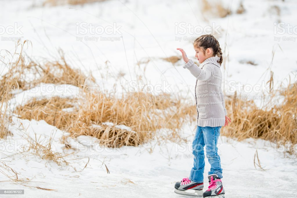 Ice Skating on a Frozen Pond stock photo