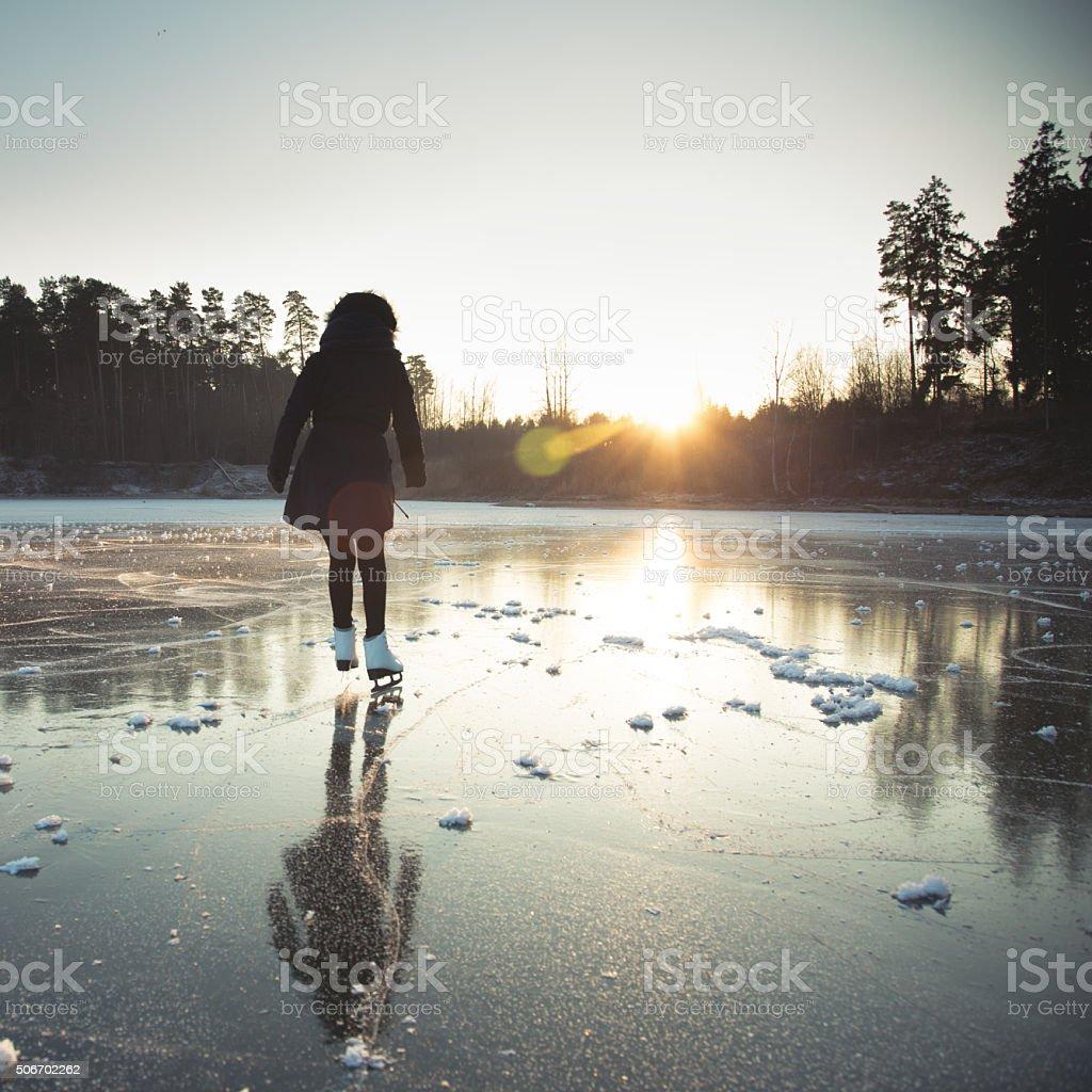 Ice skating on the frozen lake stock photo