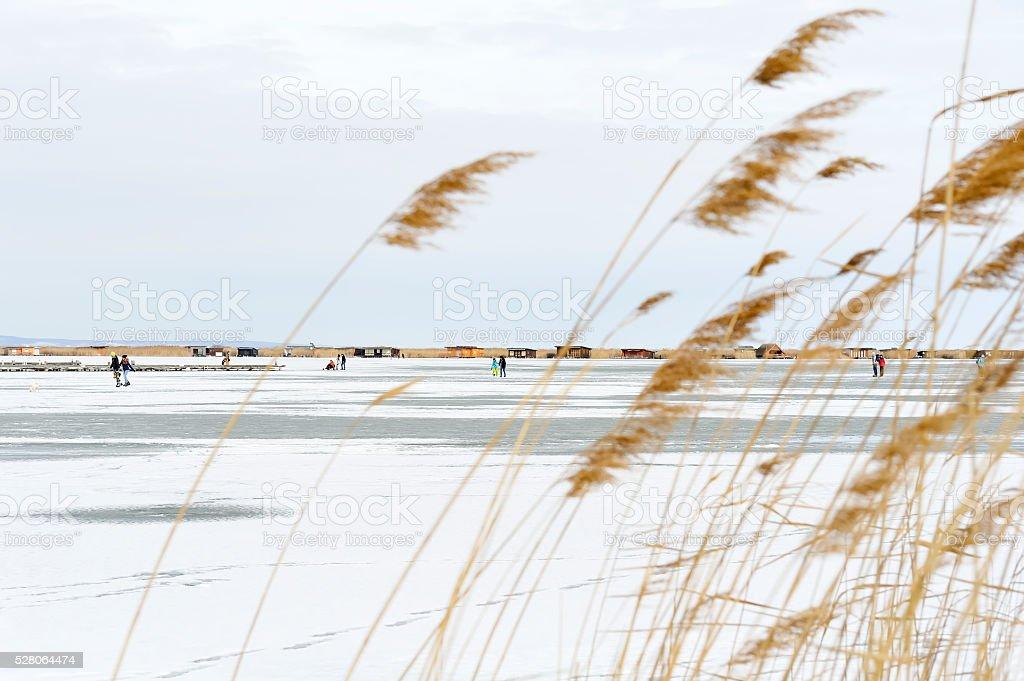 Ice skating on the lake stock photo