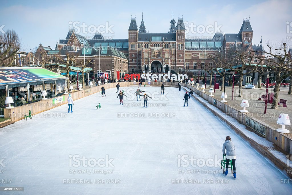 Ice skating people in winter in Amsterdam at the Rijksmuseum stock photo