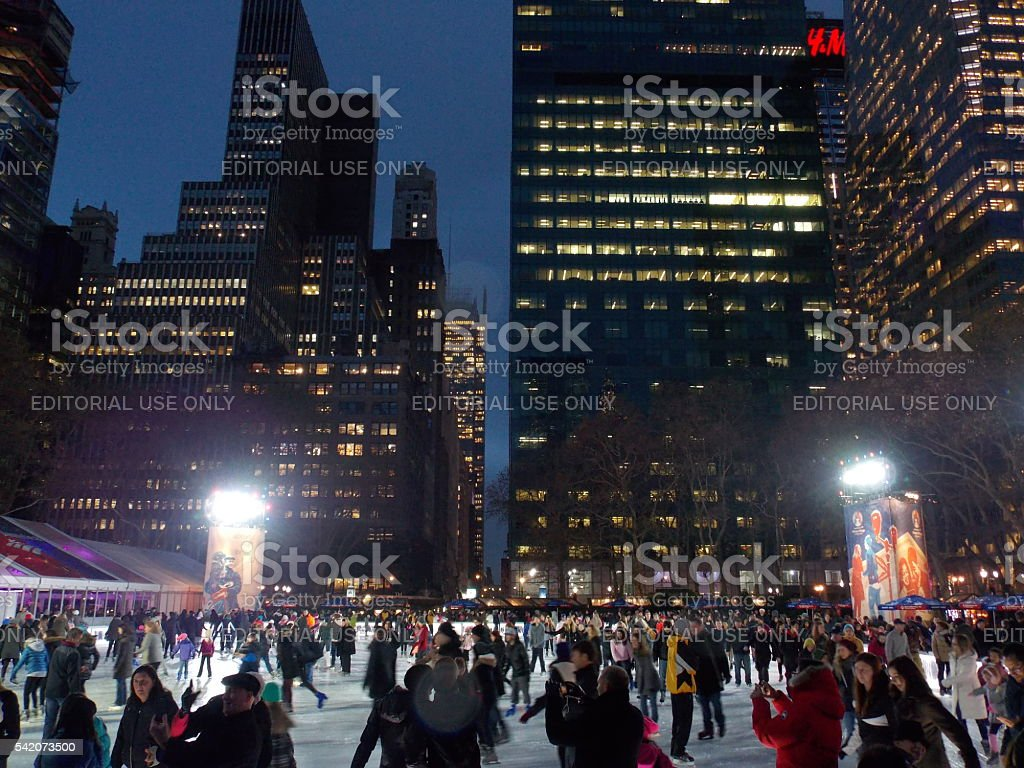 Ice Skating with Skyscrapers in the Background stock photo