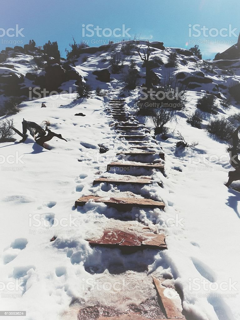 Ice, Snow covered Rock Stairs,Park Avenue Trail, Arches Park stock photo