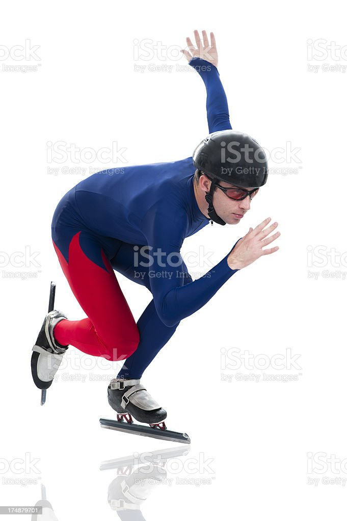 Ice speed skater in motion stock photo