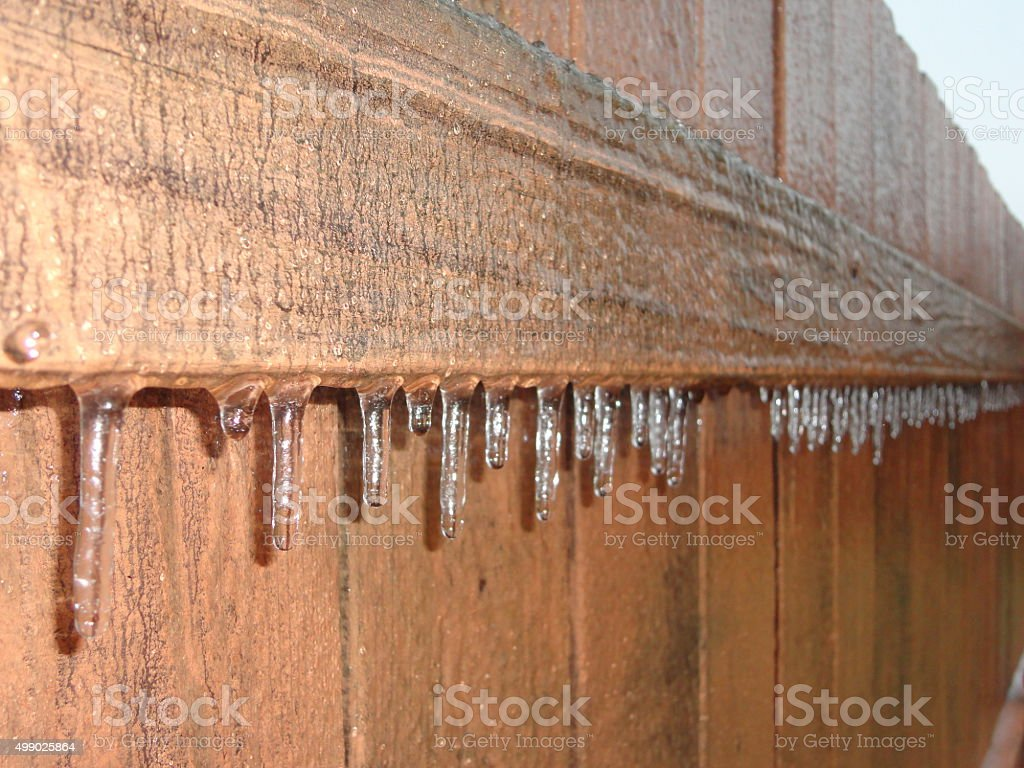 Ice storm effects on a fence stock photo
