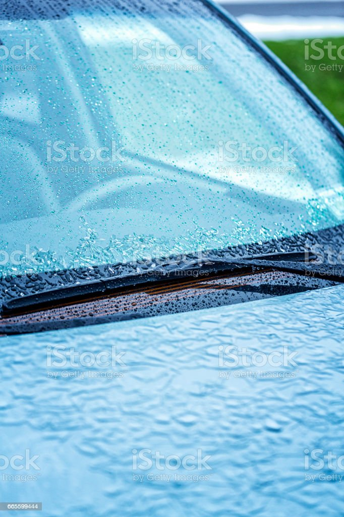 Ice Storm Freezing Rain On Car Windshield and Wipers stock photo