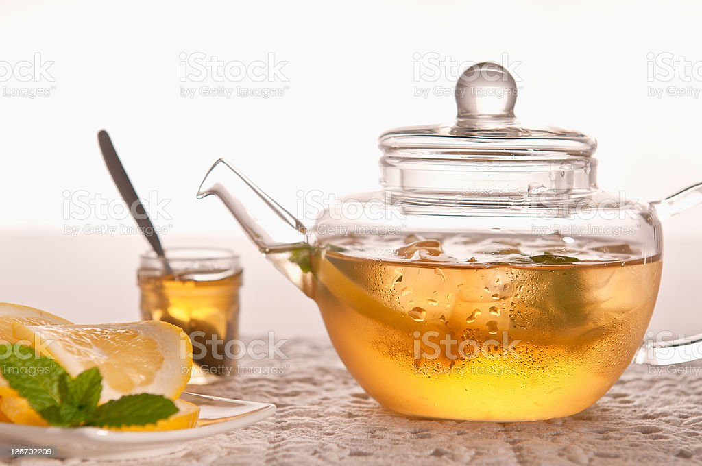 Ice Tea in Teapot With Honey, Lemon And Mint royalty-free stock photo