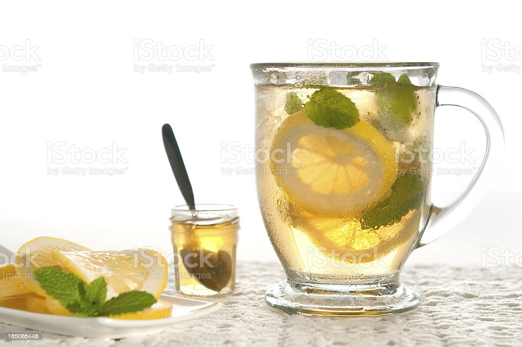 Ice Tea or Lemonade in Mug with Honey, Lemon, Mint stock photo