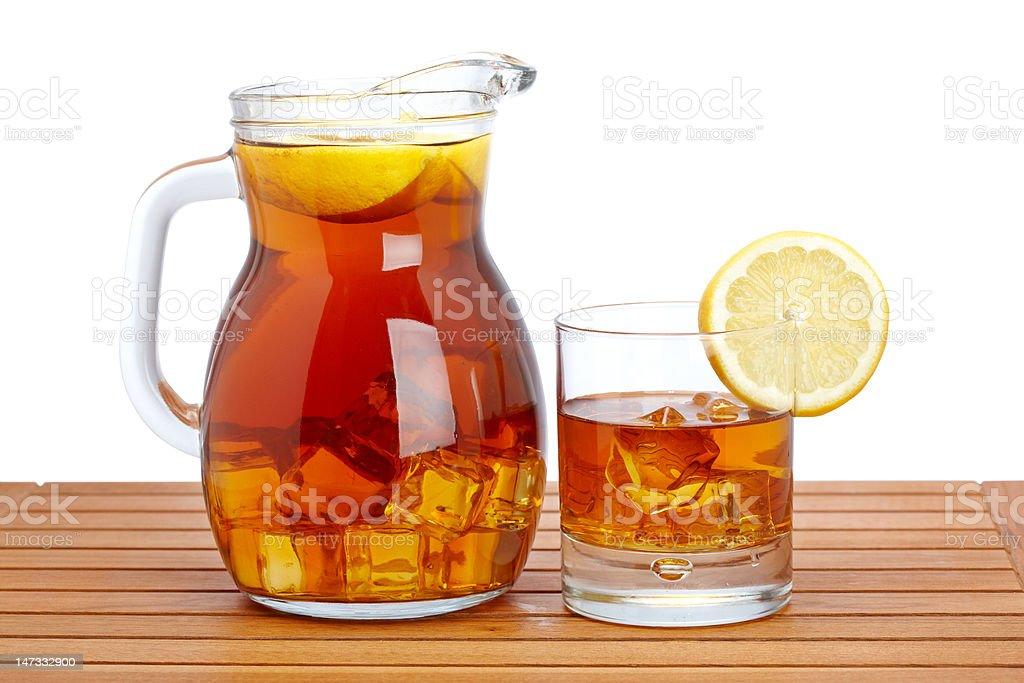 Ice tea with lemon pitcher royalty-free stock photo