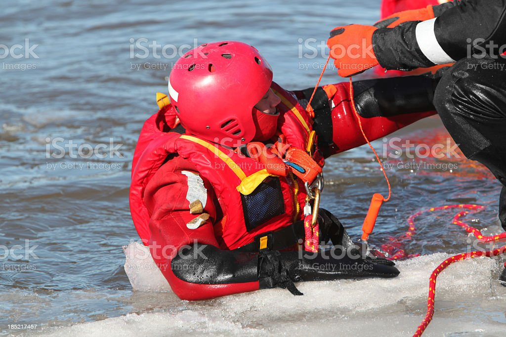 Ice water rescuers stock photo