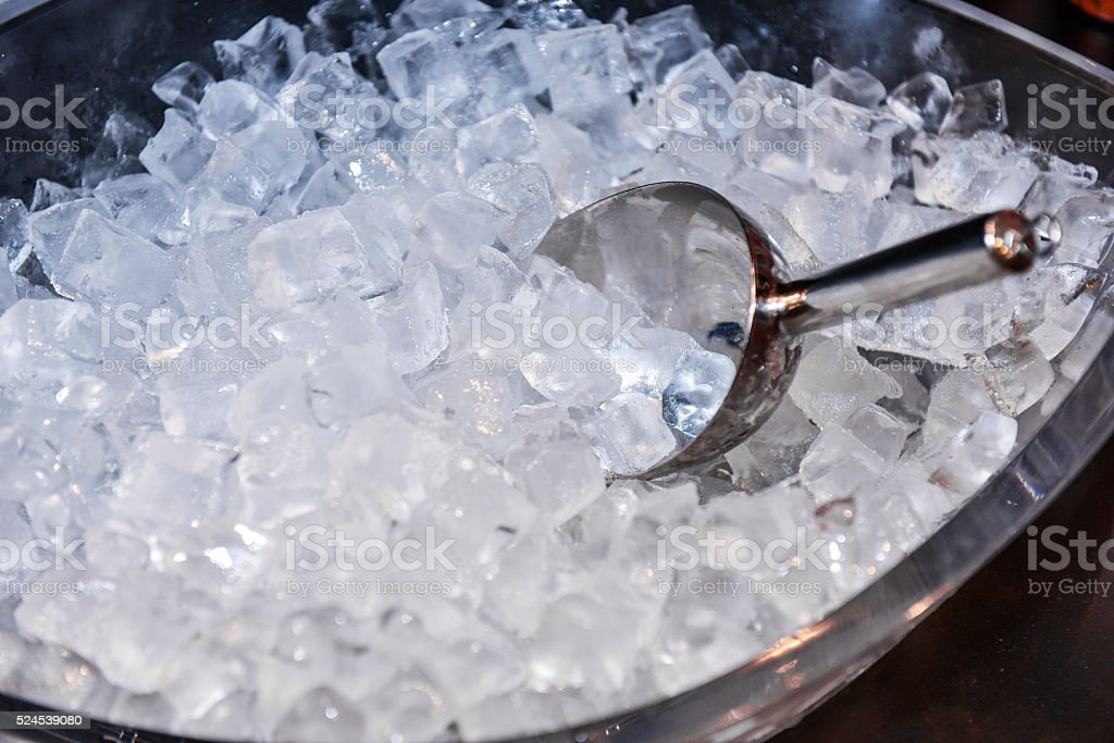 ice with scoop in ice bucket stock photo
