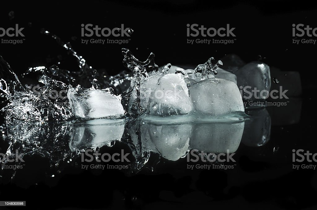 Ice with water splashes royalty-free stock photo