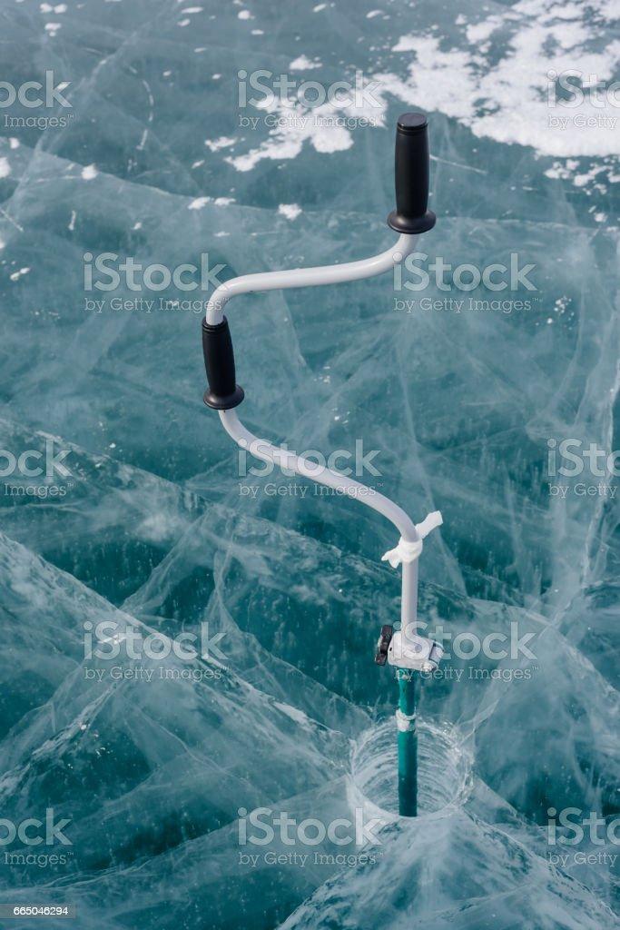 Ice-ax - ice screws on winter fishing. stock photo