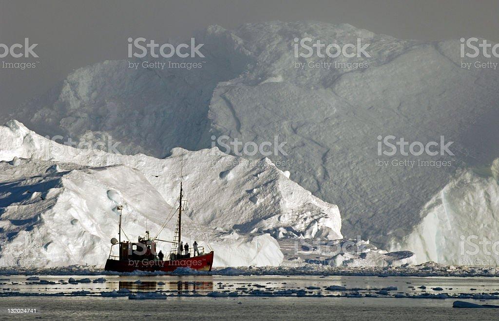 Iceberg and boat stock photo