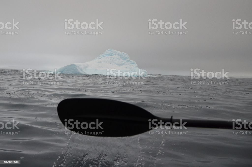 Iceberg and Kayak Paddle stock photo