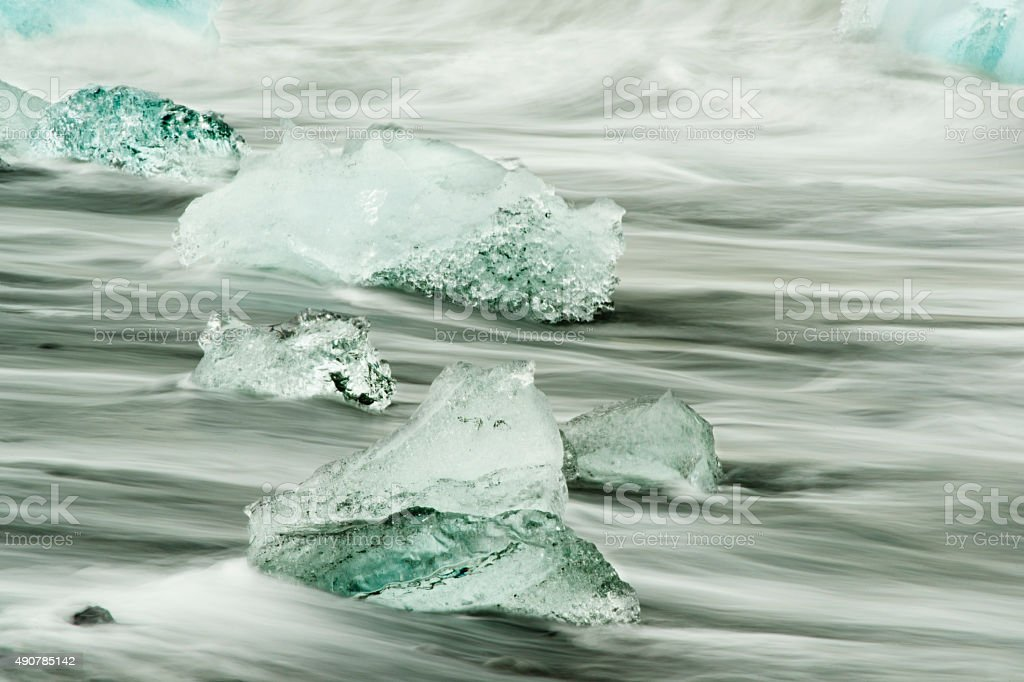 Iceberg chunks stranded on beach stock photo