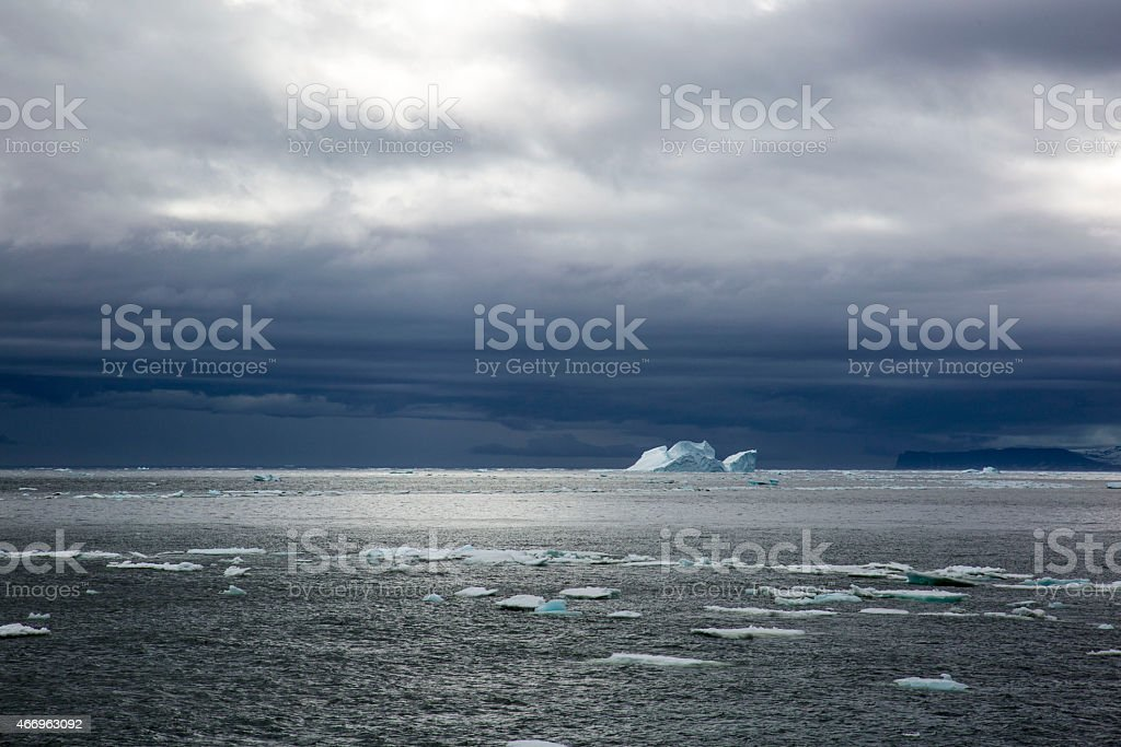 Iceberg & Drift Ice in Arctic Ocean on a Cloudy Day stock photo