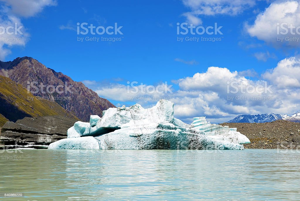 Iceberg floating in a glacial lake stock photo
