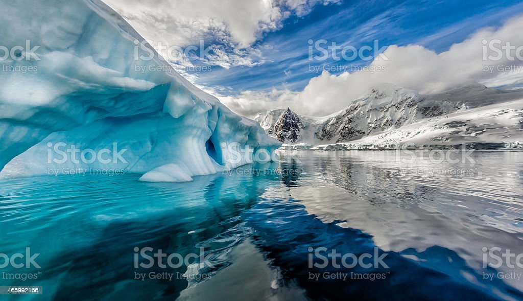 Iceberg floats in Andord Bay on Graham Land, Antarctica. stock photo