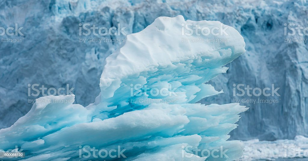 Iceberg in front of the claving Eqi glacier, Greenland stock photo