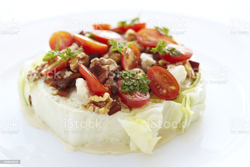 Iceberg lettuce salad with heirloom tomatoes and blue cheese stock photo
